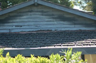 Curled shingles and siding